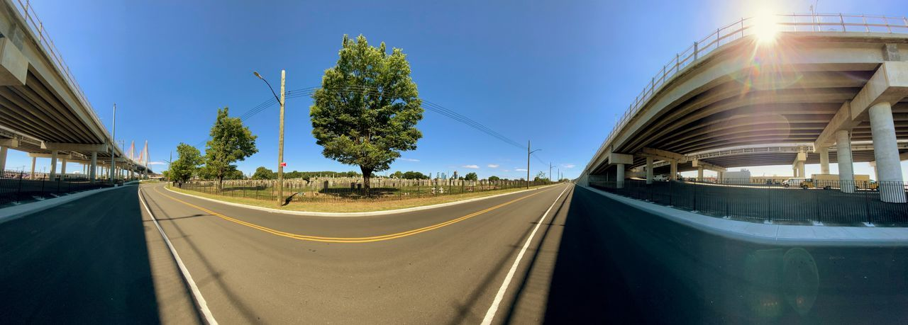 Panoramic view of road against blue sky