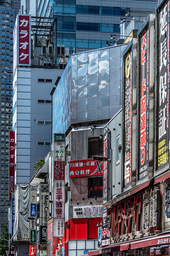 Low angle view of information sign against buildings in city