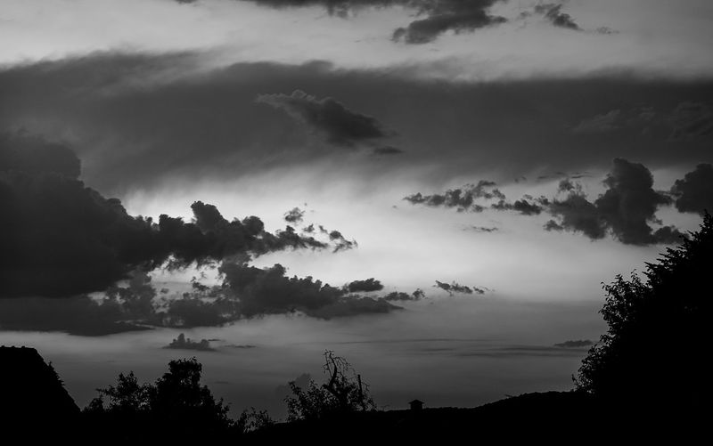 Dramatic Sky Beauty In Nature Black And White Cloud - Sky Day Dusk Growth Hell Und Dunkel Idyllic Low Angle View Nature No People Non-urban Scene Outdoors Plant Scenics - Nature Silhouette Sky Sunset Tranquil Scene Tranquility Tree