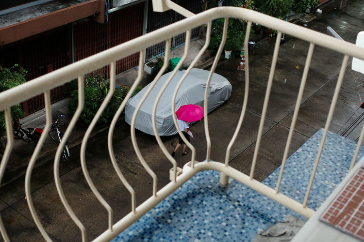 High angle view of girl on railing