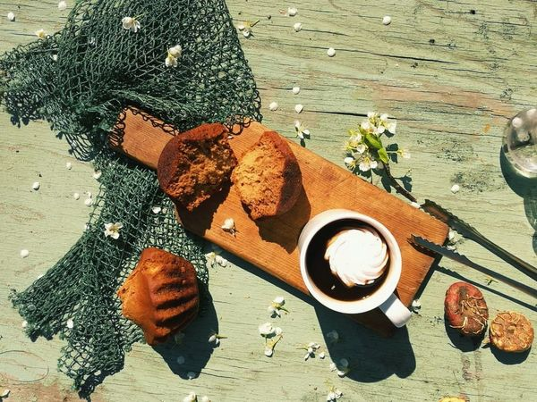 on the table Coffee Food Bakery Maffins Outdoor Photography Season  Springtime Outdoors Outdoor Life Resting Beach Sand Directly Above High Angle View Sunlight Close-up Blooming Petal Flower Head In Bloom Still Life Small Business Heroes Small Business Heroes