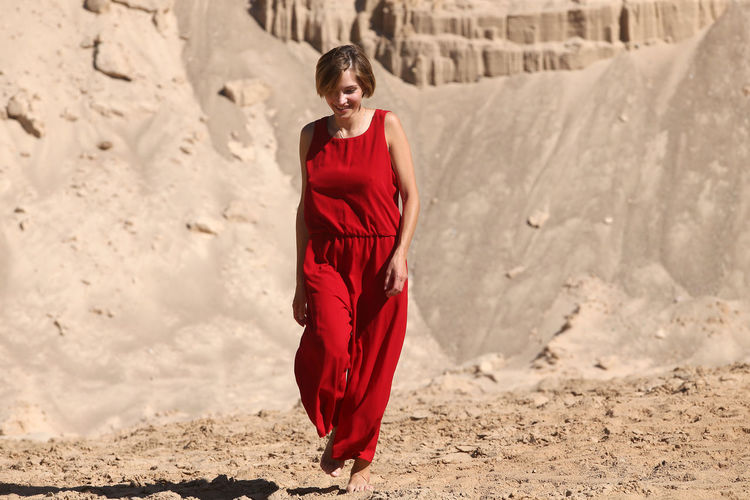 Young woman standing on sand