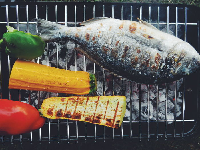 Directly Above Shot Of Fish And Vegetables On Barbeque Grill