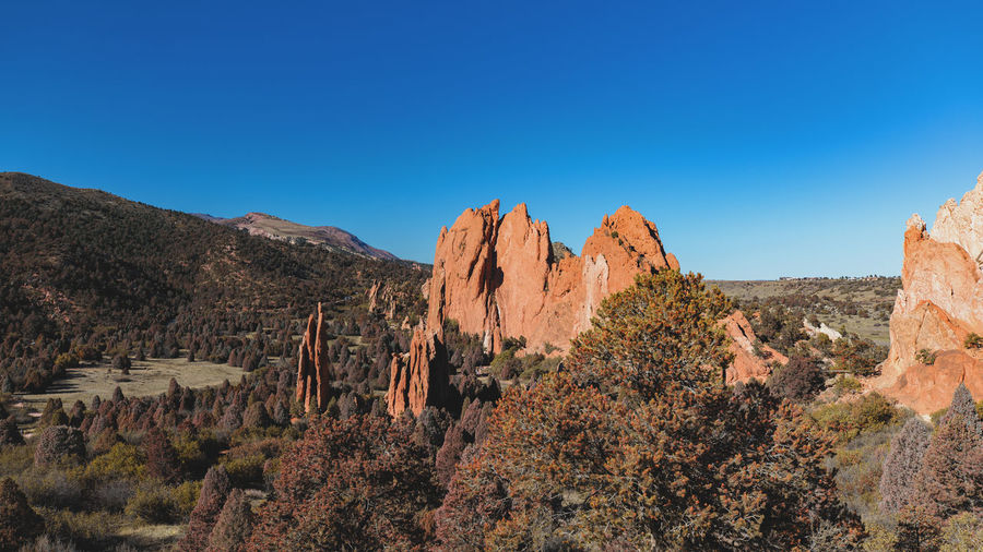 Garden of the Gods Canon Canonphotography Canon_photos Landscape Landscape_Collection Landscape_photography Sky Scenics - Nature Beauty In Nature Blue Tranquil Scene Tranquility Non-urban Scene Mountain Rock Formation Nature Rock Tree Plant Clear Sky Copy Space Environment Rock - Object No People Day Outdoors Climate Arid Climate Formation Eroded Rocks