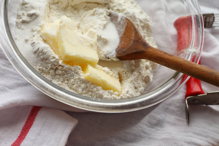 Pastry-making ingredients in a glass bowl Baking Butter Dish Towel Flour Food Food Ingredients Food Preparation Home Cooking Homemade Food Indoors  Mixing Bowl Natural Light Nobody Overhead Pastry Blender Red Sugar Textures Wooden Spoon