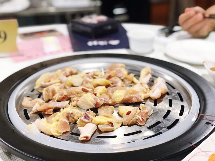 High angle view of meat in cooking pan