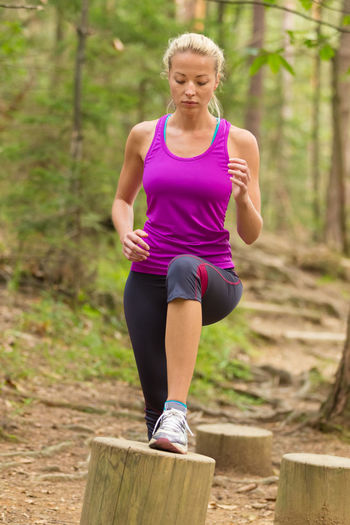 Beautiful woman exercising in forest