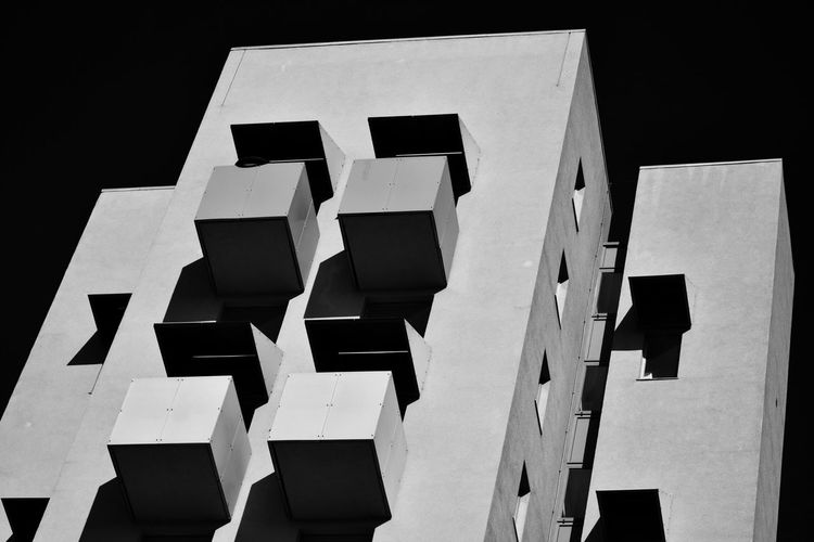 Low angle view of white building against black background