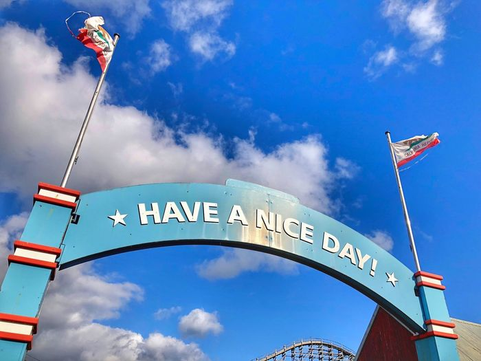 Have a nice day 👍🏻☀️ Sky Cloud - Sky Low Angle View Flag Text Western Script Nature Patriotism Day Blue Arts Culture And Entertainment Communication Architecture Outdoors No People Celebration Decoration Arch