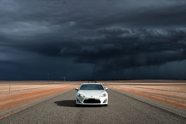 On my way to Perth, noticed a storm out to the west and stopped on the abandoned road to take some photos of my car. 86 Australia Cloud Desert Road Storm Weather Western Australia Brz Car Cloud - Sky Empty Road Nature No People Ominous Outdoors Overcast Power In Nature Road Sky Storm Storm Cloud Thunderstorm Toyota White Car