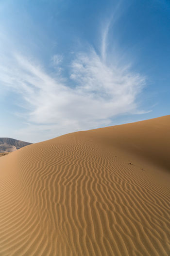 Patterns in the sand and some in the sky Adventure Arid Climate Badain Jaran Desert Blue China Cloud - Sky Exploring High Resolution Inner Mongolia Landscape Pattern Remote Sky Travel Destinations