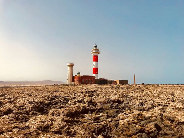 Fuerteventura Canary Islands Sky Guidance Lighthouse Clear Sky Built Structure Nature Architecture Land Building Exterior Protection Tower Sand Safety Security Beach Direction Building Day Sunlight Sea