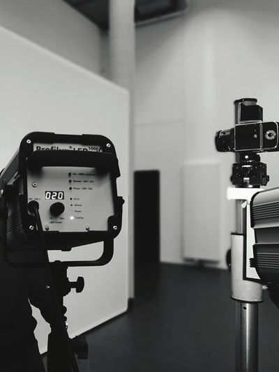 Close-up of camera on table against wall
