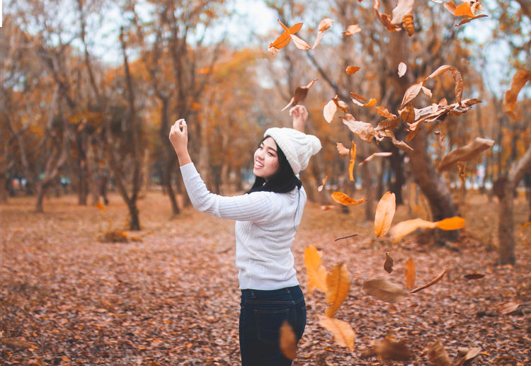 Autumn shows us how beautiful it is to let things go. Autumn Autumn Collection Autumn colors Autumn Leaves Celebration Adult Arms Raised Autumn Autumn🍁🍁🍁 Beauty In Nature Day Forest Human Arm Human Body Part Leaf Lifestyles Nature One Person Photography Themes Real People Standing Tree Vintage Women Young Women