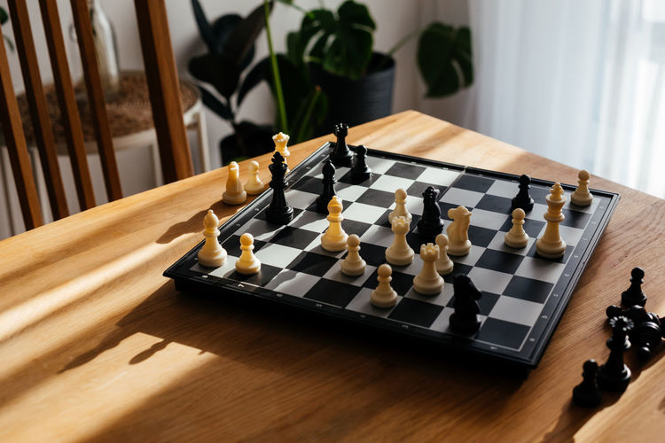 High angle view of chess playing on table at home