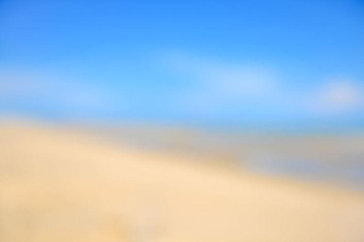 Defocused image of landscape against clear blue sky