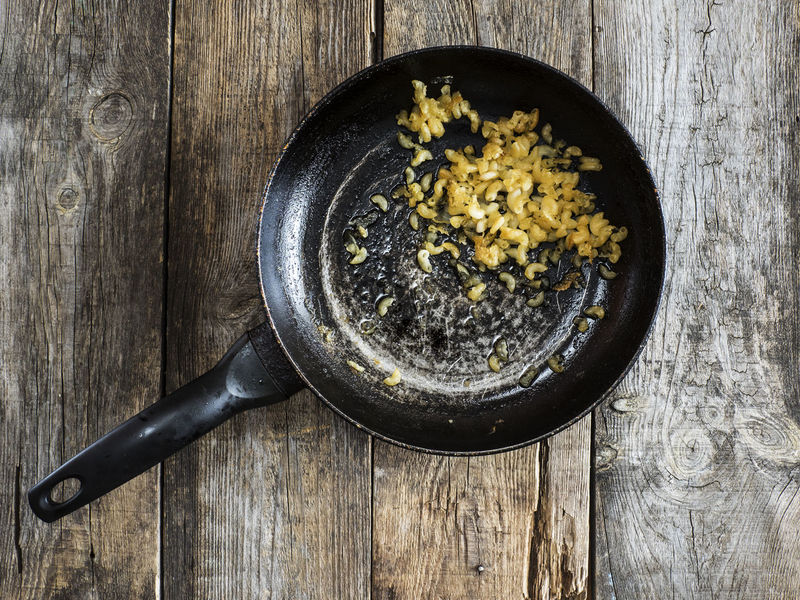 Spoiled food: dried pasta in a pan on old weathered wooden table Dark Dried Food Food And Drink Indoors  Italian Food No People Old Pan Pasta Spoiled Studio Shot Table Weathered Wood - Material Wooden