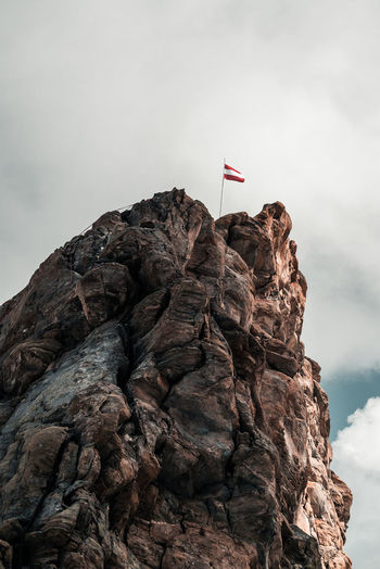 Low angle view of rock formation on mountain against sky