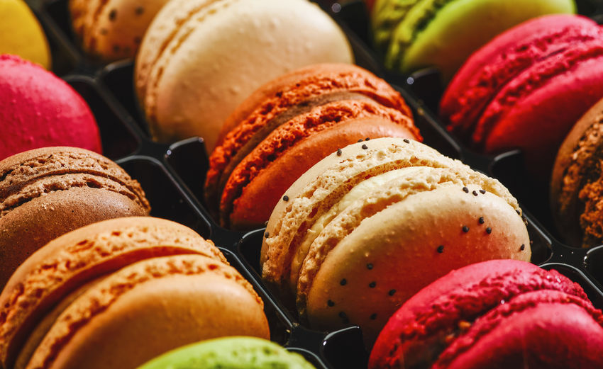 row of macaron cakes or macaroon in different colors Belgium Colors Cookies Dessert France Green Macaroons Pink Sugar Biscuit Candy Colorful Confectionery Flavor Food French Macaron Many Pastel Pastry Platic Row Sandwitch Sweet Sweet Food
