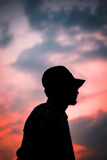 Silhouette of man standing against sky during sunset