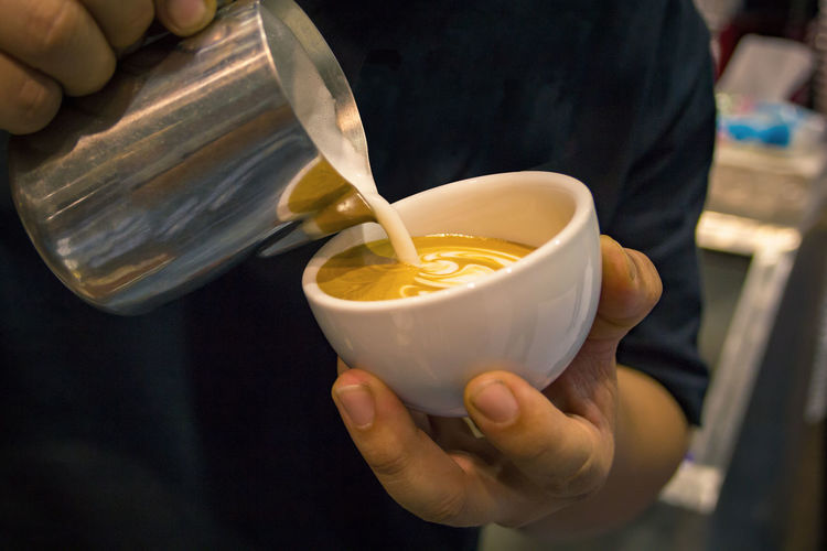 Close-Up Of Man Making Coffee