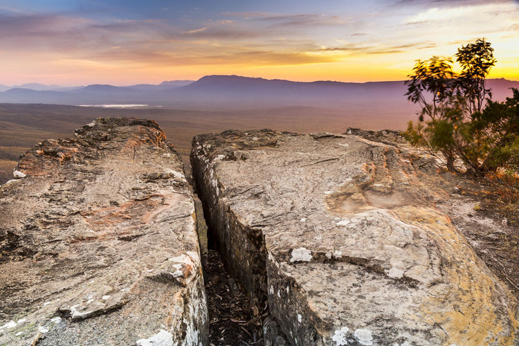 Cliff top views at sunset in the Grampians National Park, Australia Sunset Sky Scenics - Nature Beauty In Nature Tranquility Tranquil Scene Cloud - Sky Nature Tree Mountain Non-urban Scene No People Plant Rock Environment Orange Color Mountain Range Rock - Object Solid Landscape Outdoors Australia The Grampians Mountains