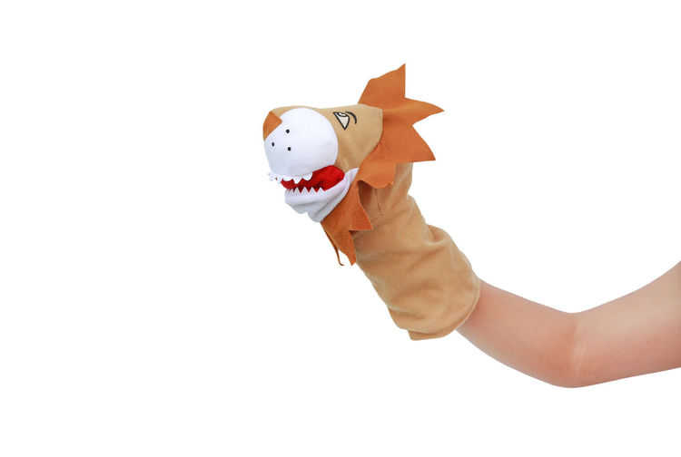Hand holding toy against white background