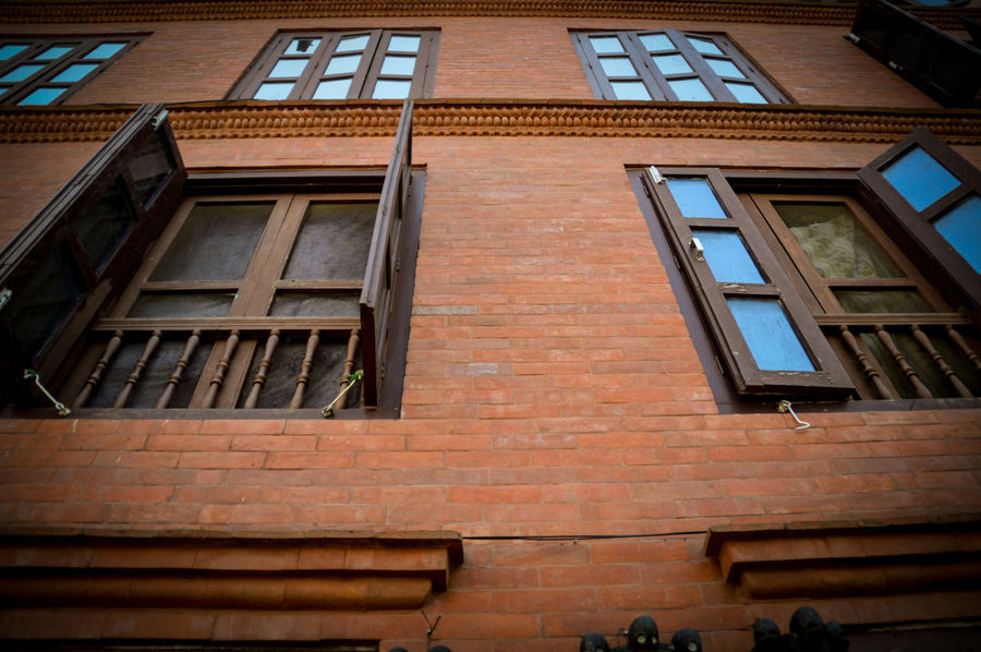 Streets Of Nepal Built Structure Kathmandu, Nepal Street No People Building Exterior Architecture Outdoors Low Angle View Travel Travel Photography Street Photography Windows Building Wall Building Windows Looking Up Perspective Personal Perspective Red Brick Wall Textured  Streets
