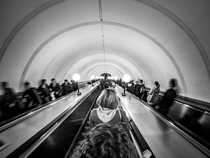 Architecture Real People Crowd Indoors  Transportation Large Group Of People Group Of People Lifestyles Built Structure Illuminated Arch Women Travel The Way Forward Direction Adult Rear View Diminishing Perspective Escalator Ceiling