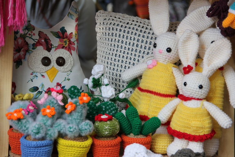 Close-up of knitted toys in market