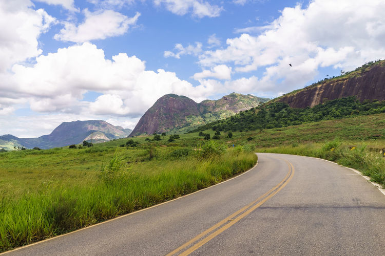 Road and landscapes of Brazil. Road Asfalt Beauty In Nature Cloud - Sky Day Diminishing Perspective Direction Dividing Line Environment Landscape Long Mountain Mountain Range Nature No People Non-urban Scene Outdoors Road Scenics - Nature Sign Sky The Way Forward Tranquil Scene Tranquility Transportation