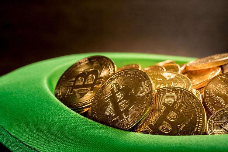 Close-up of coins in hat