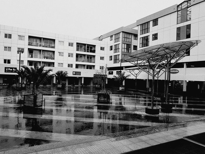 It's raining. Water Wet Building Exterior Architecture Outdoors Built Structure Courtyard  Plaza Grey Sky B&w Blackandwhite Black And White Monochrome
