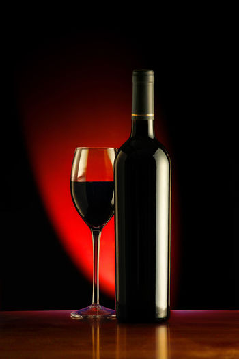 Wine and glass against a black background with red light Alcoholic Beverages Beverage Celebration Food And Drink Merlot Red Wine Reflection Alcohol Alcoholic Drink Black Background Bottle Cabernet Sauvignon Drink Drinking Glass Glass No People Red Red Wine Reflection Still Life Studio Shot Wine Wine Bottle Wineglass Winetasting
