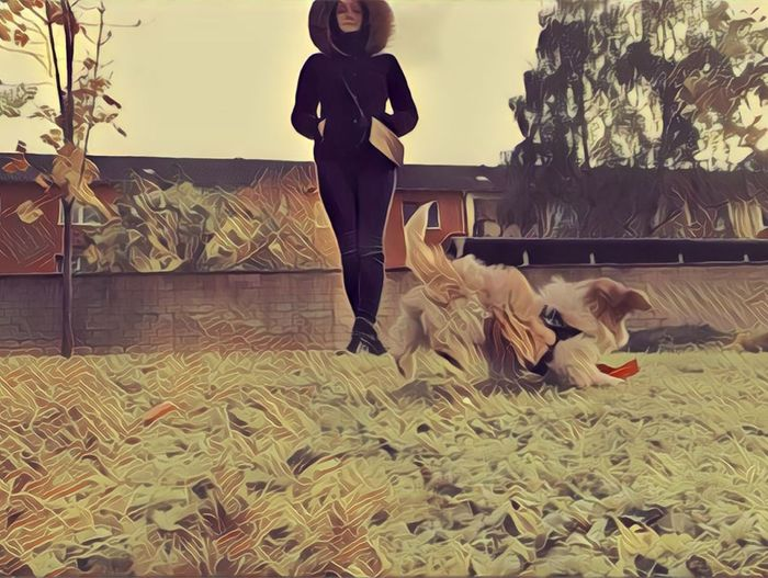 Full length of woman with dog by plants against trees