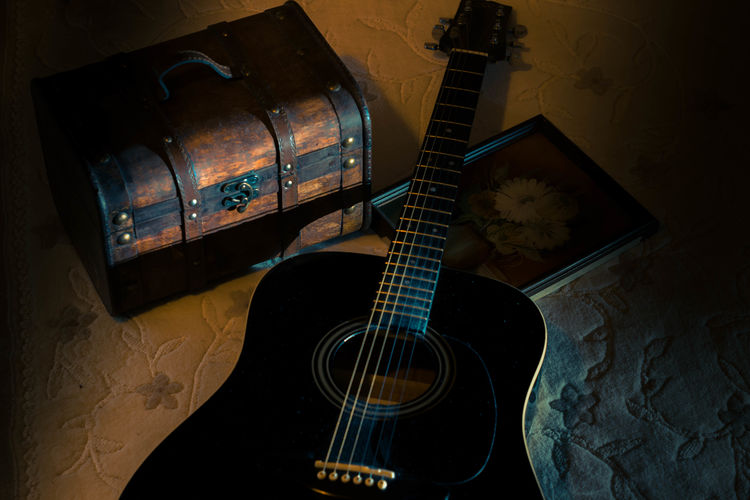 High angle view of guitar and trunk at home