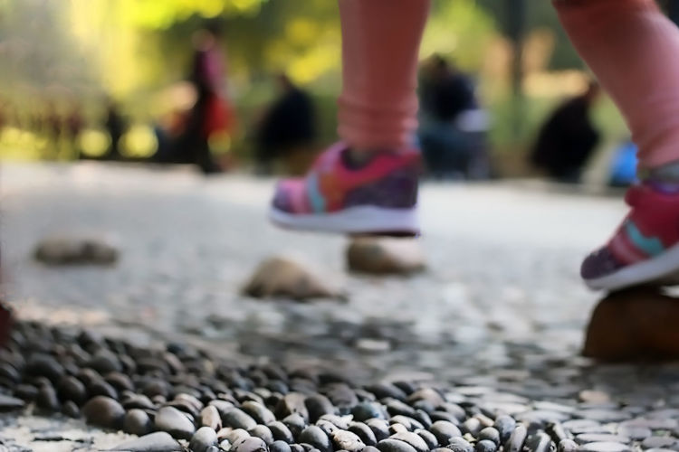 """Where The Feet Go By Damon Giannoccaro Balancing Act Children Close-up Day Feet Leisure Activity Lifestyles Low Angle View Low Section Men Outdoors Pebbles Selective Focus Shoes GREETINGS! I WELCOME YOU ALL TO ENJOY ANOTHER """"NEW RELEASE ALBUM"""" STILL IN PROGRESS! """"WHERE THE FEET GO"""" This album takes us on a unique look-and-see, as we take a closer look as to where our feet go. This unique perspective opens up a whole new world of shapes, shadows and colours. A new world of wonder can be found all around us and all we need do is open our minds. With this new album you will enjoy sights that you would normally never see... The simple things in life, can certainly bring a smile to your dial :-) Fresh On Eyeem  WHAT YOUR FEET SEE"""