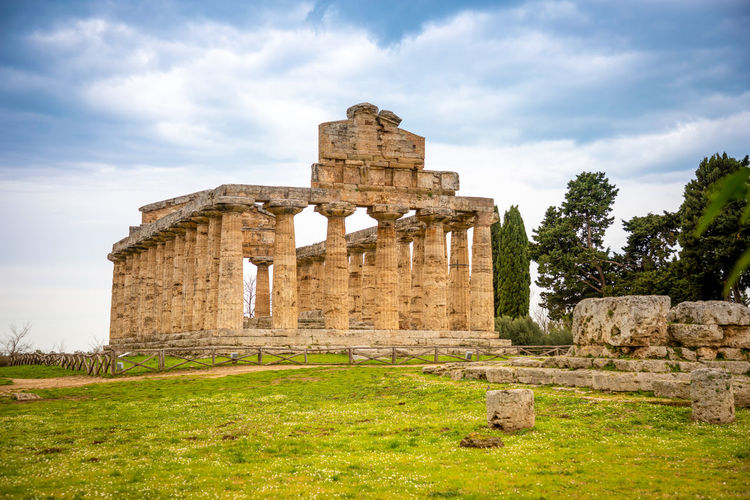 Italy Paestum History The Past Ancient Architecture Built Structure Old Ruin Cloud - Sky Sky Ancient Civilization Plant Grass Travel Destinations Old Nature Travel Tourism Day Ruined Archaeology No People Outdoors Architectural Column Deterioration Ancient History