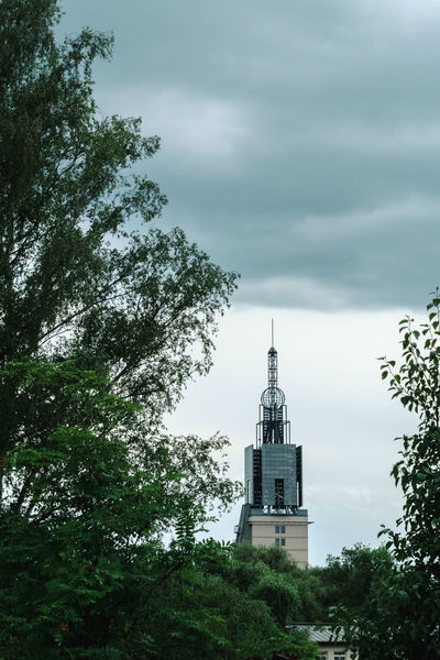 Architecture Beauty In Nature Bell Tower Branch Building Exterior Built Structure Cloud - Sky Day Green Color Growth Low Angle View Nature No People Outdoors Place Of Worship Religion Sky Spirituality Tree