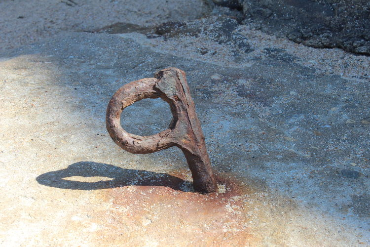 High angle view of metal ring on ground