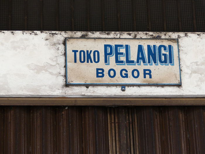 Pelangi (Rainbow) Shop, Bogor Text Communication Day No People Outdoors Close-up Colours Of Life Colour Splash Small Shop Sign Street Shops Business And Finance Street Photography Small Shop Miles Away From Seeing You Let's Take A Walk Somewhere I Remember Make Me Remember You  Somewhere Over The Rainbow Somewhere In The World Colour Of Life Bogor City Of Rain Text Somewhere Outhere Backgrounds