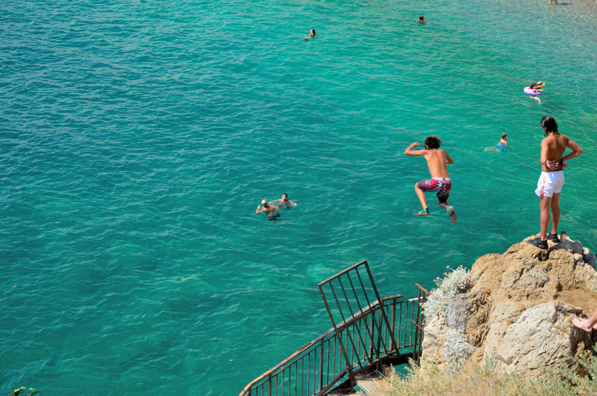 Summer, friends and sea to have fun together Adrenaline Beach Emerald Freshness Group Of People Have Fun Jump People Together Summer Sun Showcase July Hidden Gems  The Essence Of Summer Capture The Moment People Together