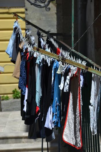 Hanging Clothing Clothesline Drying Textile Architecture Choice Laundry Variation Built Structure Building Exterior No People In A Row City Building Coathanger Side By Side Outdoors Sunlight Day