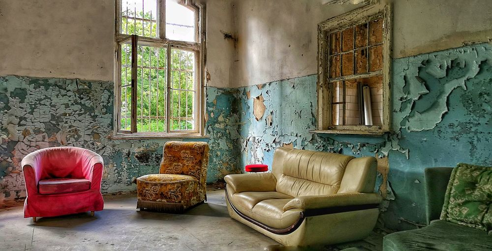 Living Room Furniture Home Interior Chair Window Sofa Armchair Home Showcase Interior Architecture Graffiti Vandalism Deterioration Run-down Bad Condition Weathered Abandoned Damaged Obsolete Peeling Off Interior