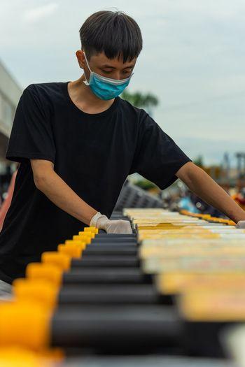 Full length of man playing piano
