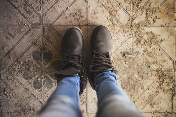 Architecture Flooring Foot Body Part Casual Clothing Directly Above Feet Flooring Havaianas Human Body Part Human Foot Human Leg Indoors  Jeans Leather Lifestyles Low Section Ojotas One Person Real People Shoe Standing Tiled Floor The Still Life Photographer - 2018 EyeEm Awards