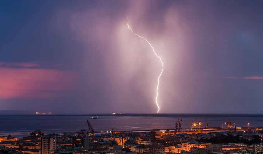 Lightning Power In Nature Storm Power Cloud - Sky Thunderstorm Beauty In Nature Architecture Sky Illuminated Night City Building Exterior Forked Lightning Warning Sign Storm Cloud Built Structure Nature Water No People Cityscape Ominous Outdoors Meteorology