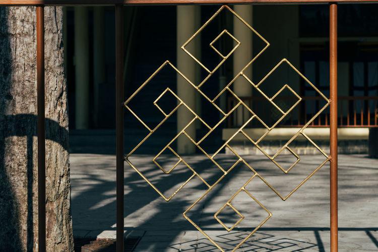Metal railing against building
