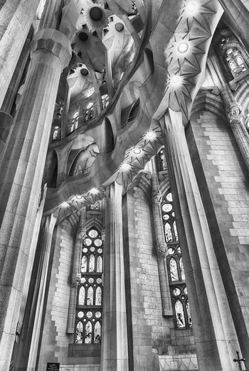 BARCELONA - AUGUST 9: Interior design of the Sagrada Familia, the most iconic landmark designed by Antoni Gaudi in Barcelona, Catalonia, Spain, on August 9, 2017 Low Angle View Architecture Built Structure Religion Place Of Worship Spirituality Belief Art And Craft Building Building Exterior Human Representation Architectural Column Representation Statue Sculpture No People Creativity Ceiling Ornate