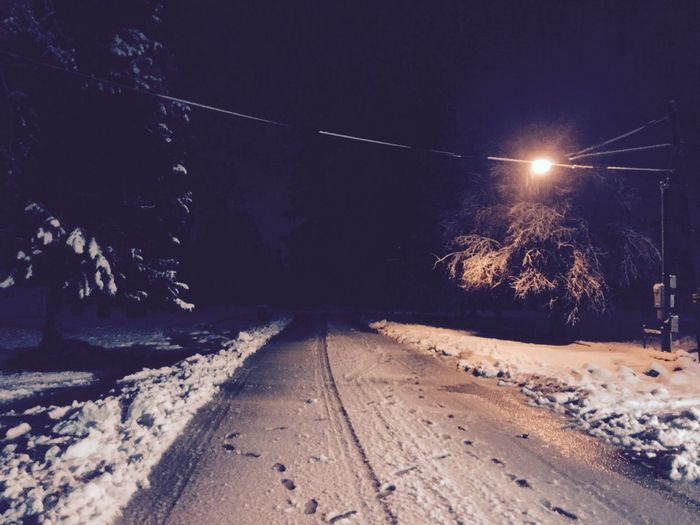 Connected By Travel Outdoors Night Snow Illuminated Weather Transportation Railroad Track No People Street Light Nature Cold Temperature Winter Tree Landscape Scenics Beauty In Nature Lost In The Landscape EyeEm Nature Lover